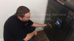 Jason Jones of Key Elements cracking a Chatwood Milner safe